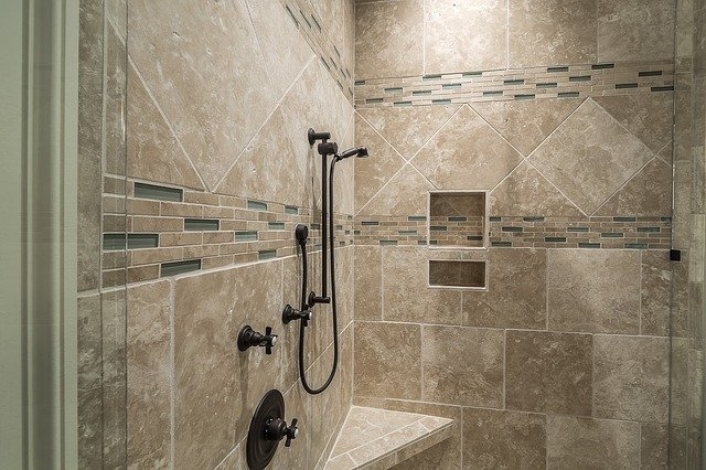 Ceramic wall panels on bathroom wall