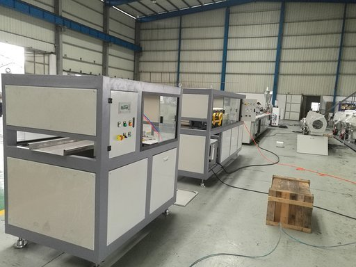 Cutter machine for PVC wall panel line showing control panel