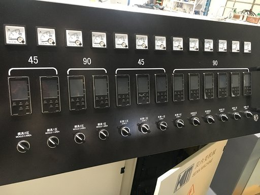 Extruder control panel showing Omron temperature controller panels