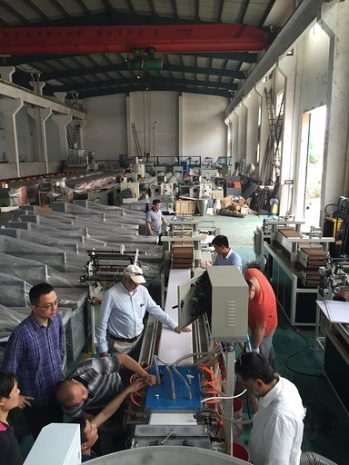 Customers inspecting the PVC ceiling panel making line